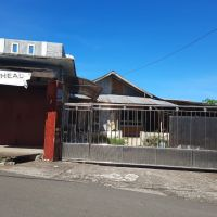 Sebidang tanah seluas 500 m2 berikut bangunan SHM No.243 di Kabupaten Minahasa Utara