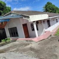 Sebidang tanah seluas 1257 m2 berikut bangunan SHM No. 763 di Kota Bitung