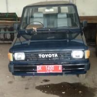 Lot.12; Mobil Toyota KF 50 Super Long, DK 1400 A di Kota Denpasar (BPKAD Provinsi Bali)