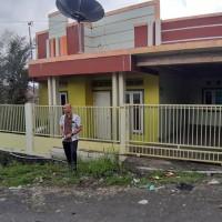 Sebidang tanah dengan total luas 144 M2  berikut bangunan diatasnya sesuai SHM No.1323/Buha di Kota Manado