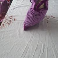 1 (satu) unit Tas mukena warna ungu bahan rajutan benang polyster ukuran lebar 21 cm tinggi 24 cm  di Kota Padang