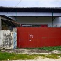 1 bidang tanah berikut Gudang diatasnya luas 704 m2,terletak di Jl.Lantigau,Masigi,Parigi SHM No.562 an.Romy Malino (BNI Kanwil Manado)