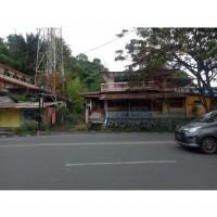 Sebidang tanah seluas 1.489 M2 berikut bangunan diatasnya sesuai SHM No.2322/Paal Dua (eks 220/Paal Dua) di Kota Manado