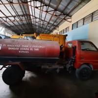 Angkasa Pura Kupang - Truk Tangki Air Isuzu TLD58 di Kota Kupang