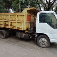 6. PEMDA.M.ENIM-Satu unit kendaraan roda empat, Isuzu Truck NKR, Putih, Thn 2005, Rusak, Mesin Mati