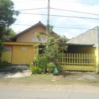 Sebidang tanah dan bangunan Sertifikat Hak Milik No. 1249 LT : 398 M2 terletak di Desa Siman, Kecamatan Kepung, Kabupaten Kediri