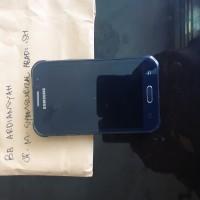 1 (satu) unit handphone merk samsung J1 warna hitam yang dirampas untuk negara kondisi rusak (Kejari Bulukumba)