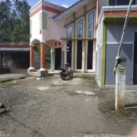 Sebidang tanah seluas 260 M2 berikut bangunan diatasnya seluas 224M2 sesuai SHM No.09/Kali di Kab. Minahasa Tenggara
