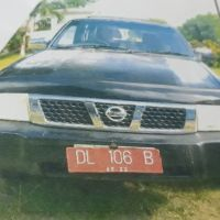 1 (satu) unit station wagon merek Nissan Terano warna Hitam tahun 2004 No. Polisi DL 106 B