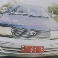 1 (satu) unit station wagon merek Toyota Kijang warna biru metlik tahun 2004 No.Polisi DL 158 B