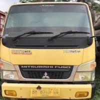 4. Kejari Jambi melelang 1 Paket Truck Mitsubishi Center PS 125 Tahun 2017 warna kuning BH 8515 QU beserta kayu sebanyak 9.44 m3 STNK ADA