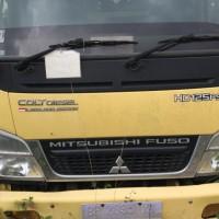 2. Kejari Jambi melelang 1 Paket Truck Mitsubishi PS 125 warna kuning BH 2035 XY beserta kayu sebanyak 9.65 m3