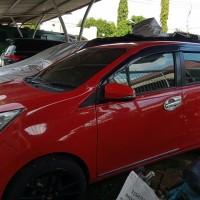 [Kejari Prabumulih]16. Satu Unit Kendaraan Roda Empat merk Toyota Calya Warna Merah (tanpa surat)