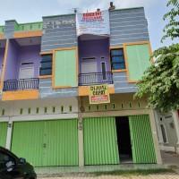 BRI Abunjani Melelang Sebidang tanah dan bangunan ruko 2,5 lantai LT. 128 m², LB. 134 m² SHM Nomor 1612/Tanjung Sari