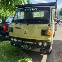 KPP Surakarta_2: Truck, Merk Mitsubishi Type FE.104(4B), Tahun 1989, Nopol  AD-1389-JA, Warna Kuning Muda, STNK&BPKB ada