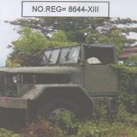 1 (satu) unit Truck + Attachment Merek Reo KM 250 Warna Hijau Tua tahun 2004 No.Reg.8644-XIII kondisi rusak berat