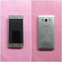 Kejari Kab.Probolinggo Lot 27) Hand Phone merk Samsung type J2 warna silver